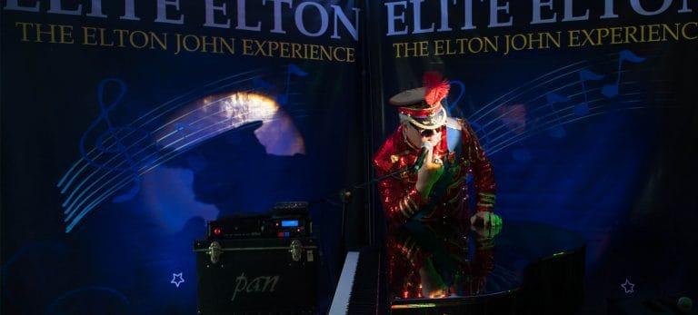 Elite Elton - Elton John Tribute leaning on piano