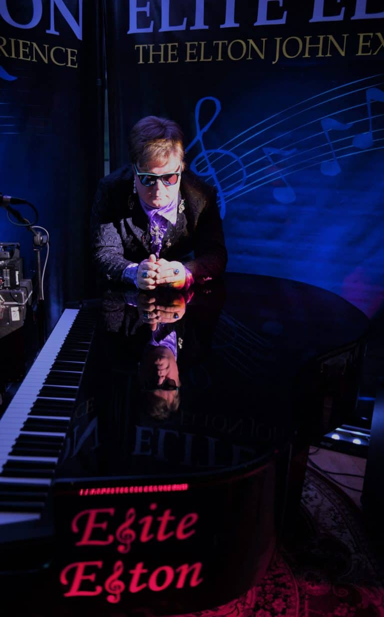 Elite Elton (Elton John impersonator) on piano artic blue